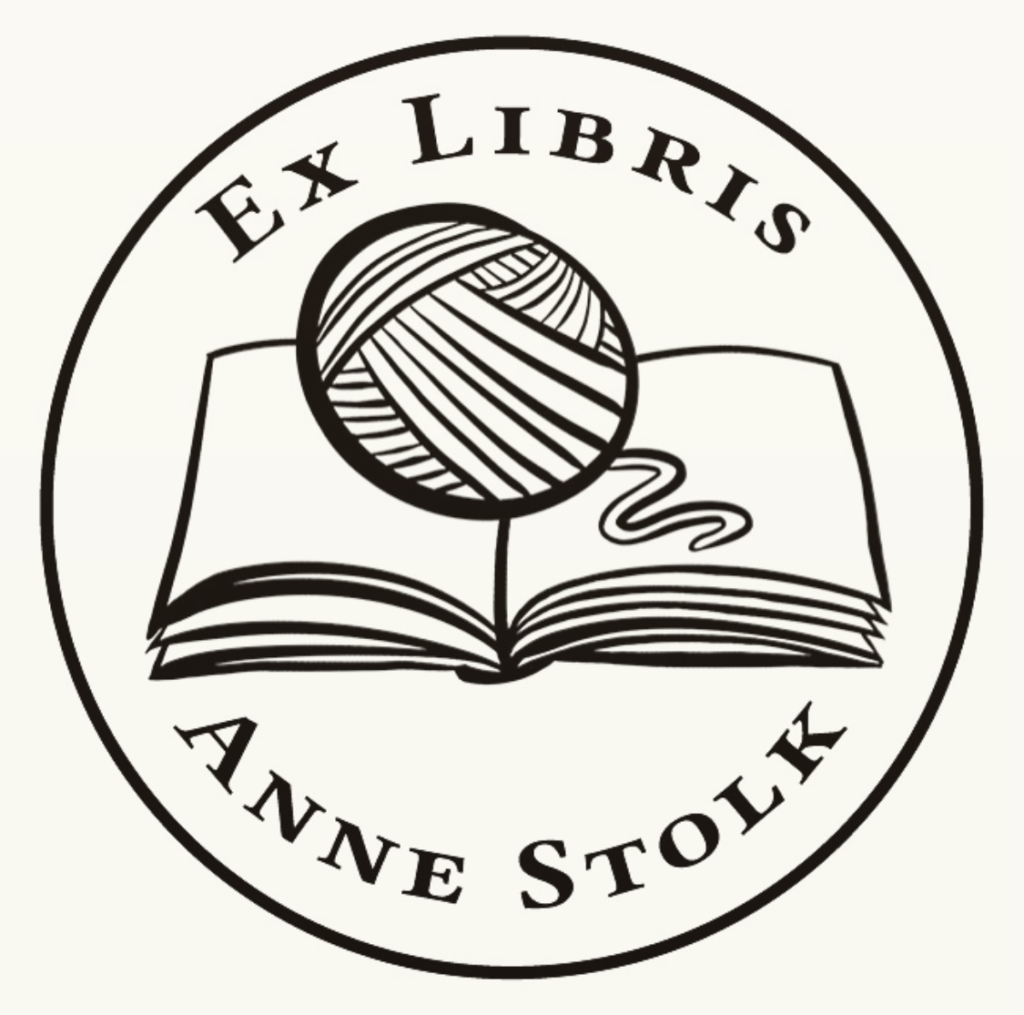 An illustrated logo of an Ex Libris stamp depicting an open book with a ball of yarn on top